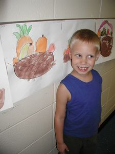 Connor next to a picture he drew